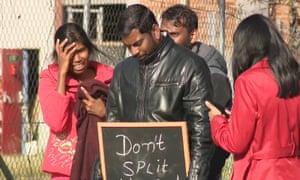 Karthika Gnaneswaran, left, at a protest in Sydney