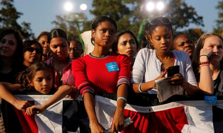 Black voters watch Barack Obama speak in North Carolina