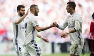 Karim Benzema of Real Madrid celebrates with his team mate Cristiano Ronaldo after scoring the opening goal against Athletic Bilbao.