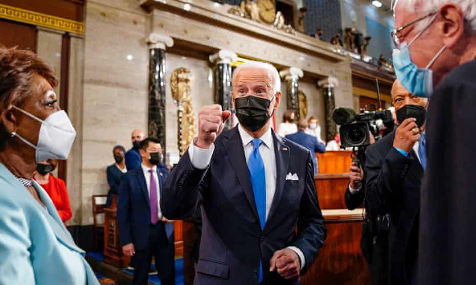 Joe Biden leaves the House chamber with Representative Maxine Waters and Senator Bernie Sanders after addressing a joint session of Congress in April.