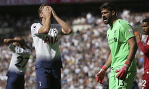 Tottenham's Harry Kane holds his head in his hands after missing a chance against Liverpool at Wembley.