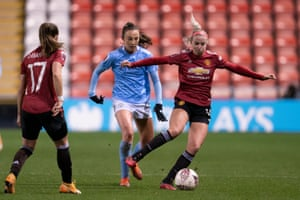Manchester United and Manchester City in action in the WSL last month. Kelly Simmons pays tribute to the work done by clubs.