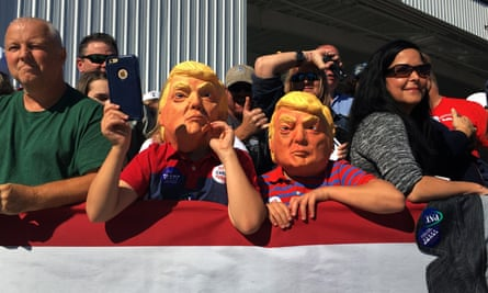 Children wearing masks wait for Donald Trump to hold a campaign rally in Wilmington, North Carolina.