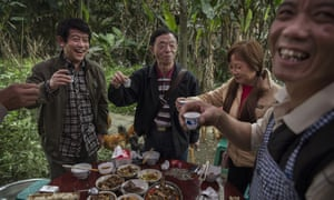 Villagers in Bagou, Sichuan province, toast a birthday with wine.