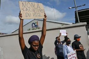 An activist holds a placard reading 'No to rape culture' at a demonstration against Ivory Coast TV channel Nouvelle Chaine Ivoirienne.
