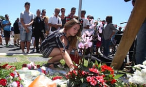 People lay tributes to the victims at the Promenade des Anglais in Nice.