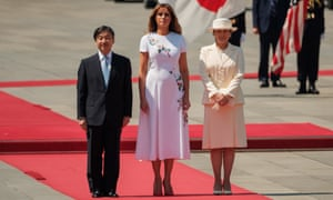Japan's Emperor Naruhito, US First Lady Melania Trump and Japan's Empress Masako stand during a welcome ceremony at the Imperial Palace in Tokyo