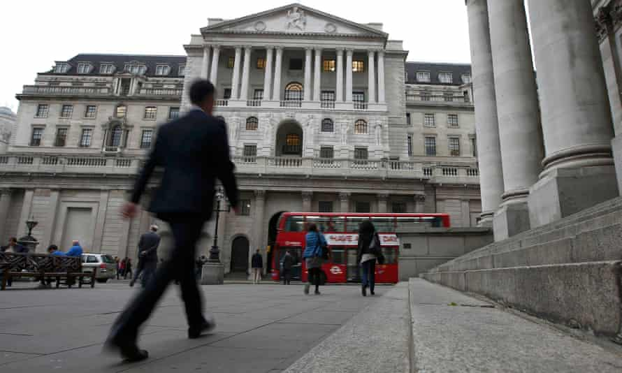 Commuters walk past the Bank of England in London, Britain October 7, 2016.