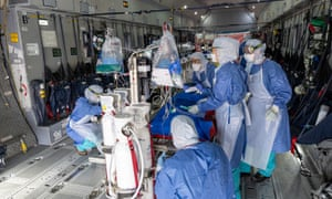 Medical staff check equipment installed in an Airbus A400M prior to an evacuation of patients infected with Covid-19 at Guiana air-base in Matoury, near Cayenne.