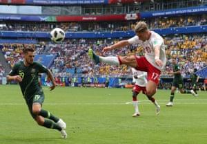 Denmark's Jens Stryger Larsen brings down a high ball.