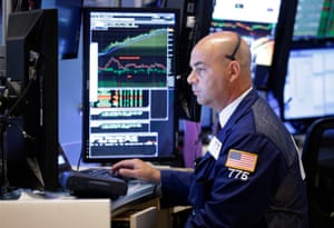 Traders work on the floor of the New York Stock Exchange today.