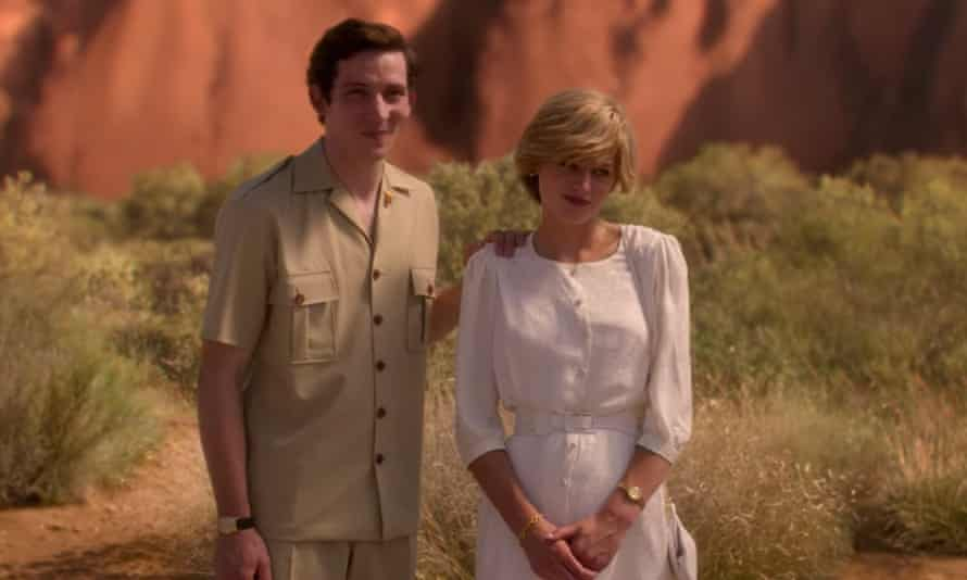 Josh O'Connor as Prince Charles and Emma Corrin as Princess Diana in front of Uluru.