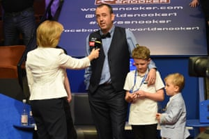 Hazel Irvine interviews Mark Williams as he celebrates his victory with his children.