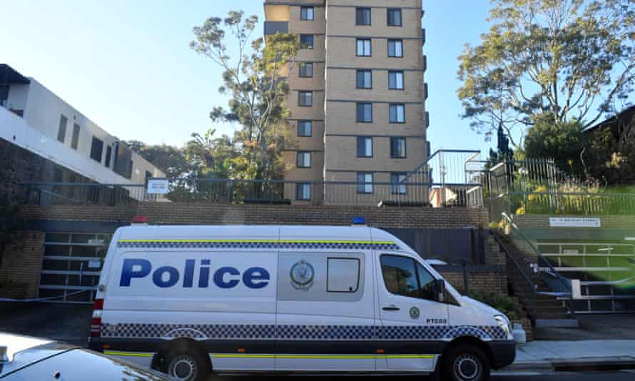 Sydney police patrol outside an apartment block. The building has been locked down under armed guard after eight residents across five different units tested positive to Covid-19.