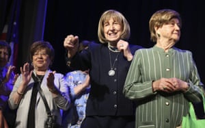 New York, US. Holocaust survivors Lillian Feintuch, (centre) and Helen Kurtz (right) dance with other survivors during a concert honouring their lives and celebrating the end of their pandemic isolation, at the Yeshivah of Flatbush theatre in Brooklyn