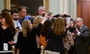 Sen. Graham speaks to reporters outside the Senate chamber during a dinner break.
