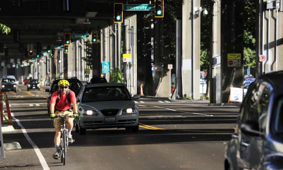 A Seattle cyclist wearing the mandatory helmet.