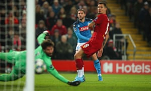 Dries Mertens of Napoli makes it 1-0 at Anfield, driving his shot past Alisson.