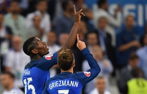 Griezmann and Paul Pogba point skywards after the second.