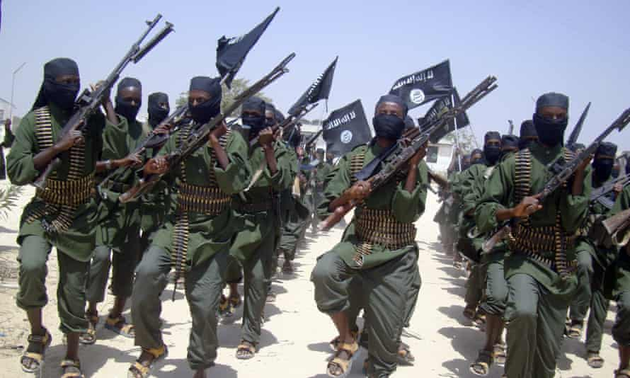 Al-Shabab fighters march with their weapons during military exercises on the outskirts of Mogadishu, Somalia, in this 2011 file photo.