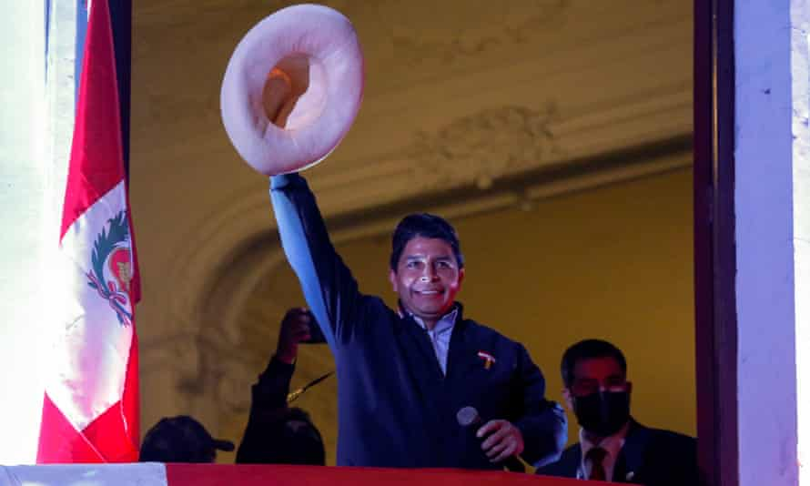 Leftwing presidential candidate Pedro Castillo of the Perú Libre party gestures to his supporters from the balcony of his party headquarters in Lima after his election win.