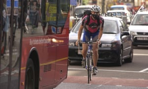 Cyclist in London with mask