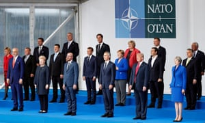 Heads of state pose for a traditional 'family' photograph