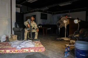 An Afghan army soldier sits inside the Bagram airbase.