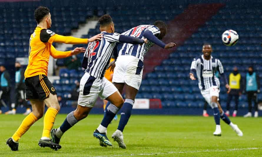 Mbaye Diagne heads in West Brom's equaliser against Wolves.