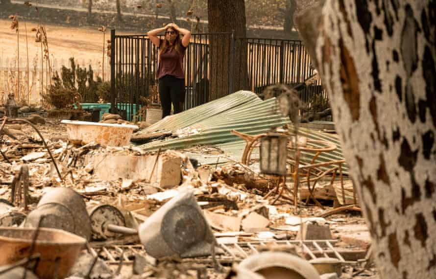 A resident looks over the charred remains of her family home in Vacaville, California.