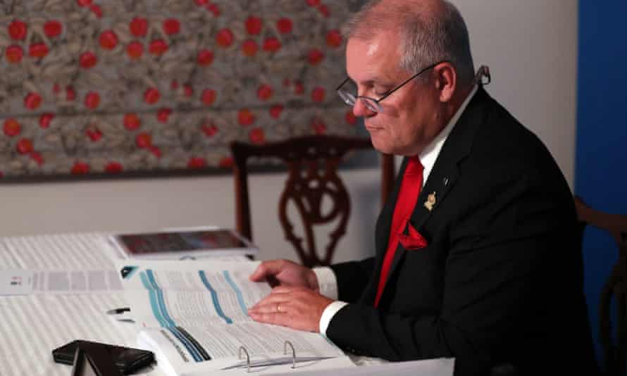 A handout picture released by the Australian Prime Minister's Office shows Scott Morrison attending an online session of the Apec summit from Canberra