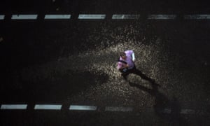 Sydney, Australia A man crosses the street in heavy rain as a late afternoon thunderstorm hits the city