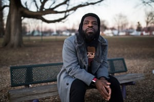 Author and Poet Hanif Abdurraqib sits outside of Scottwood Elementary School in Columbus, Ohio. He is photographed to accompany a Q&A in the Books section