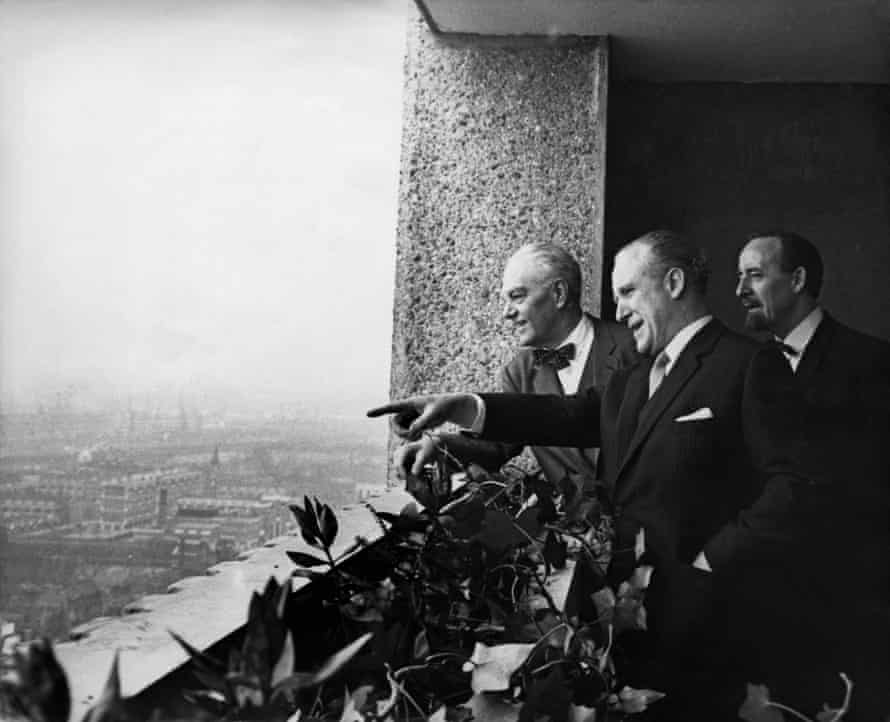 Erno Goldfinger, left, admires the view from Balfron Tower in Poplar, east London, with then Greater London Council leader Desmond Plummer, centre, and housing chairman Horace Cutler in 1968.