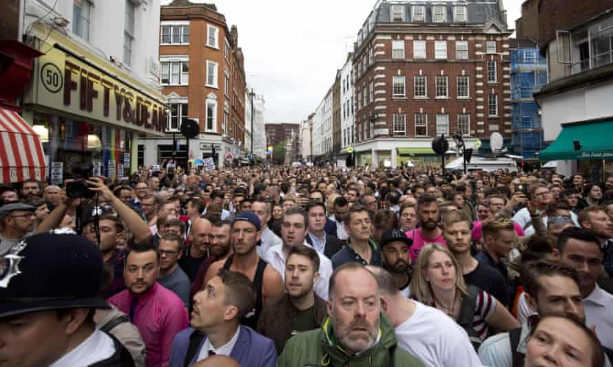 People gather in Old Compton Street in the Soho district of London for a vigil in commemoration and solidarity with the victims of the Orlando massacre.