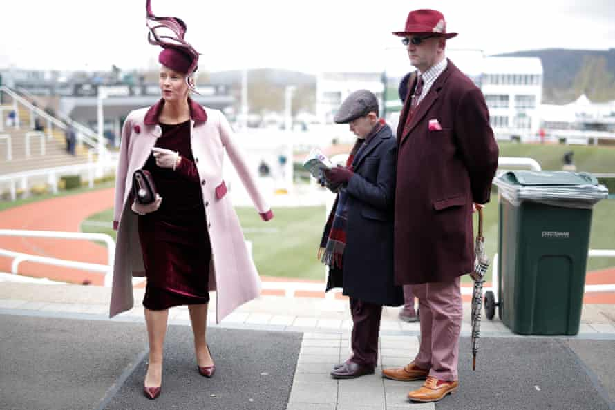 A family attend Ladies Day on day two of the Cheltenham Festival.
