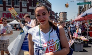 Alexandria Ocasio-Cortez marches during the Bronx's pride parade two weeks ago.