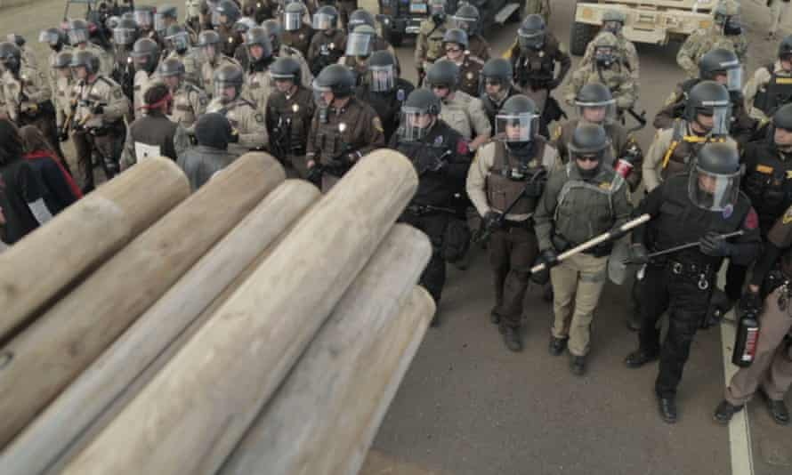 Police marching at a protest against the North Dakota pipeline