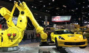 Industrial robots holding a sports car