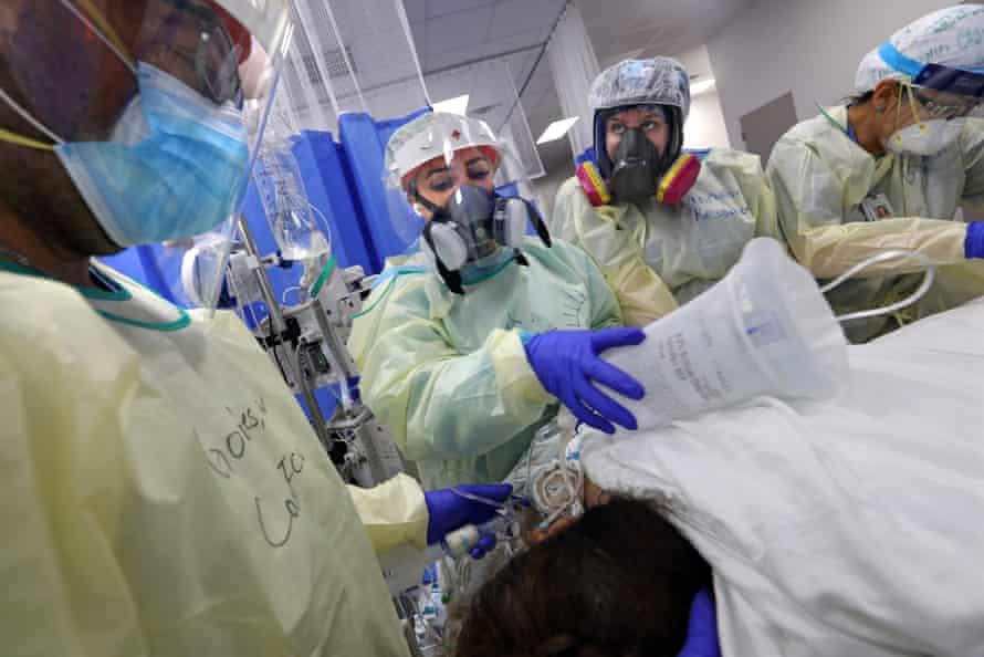 Nurses treat a patient at Doctors Hospital at Renaissance in Edinburg, Texas in July.