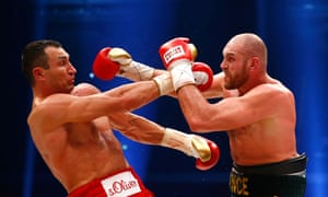 Wladimir Klitschko is rocked back by a Tyson Fury assault.
