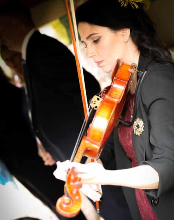 Hindman playing violin at a friend's wedding.