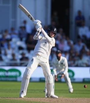 Stuart Broad hits a ball to the boundary.