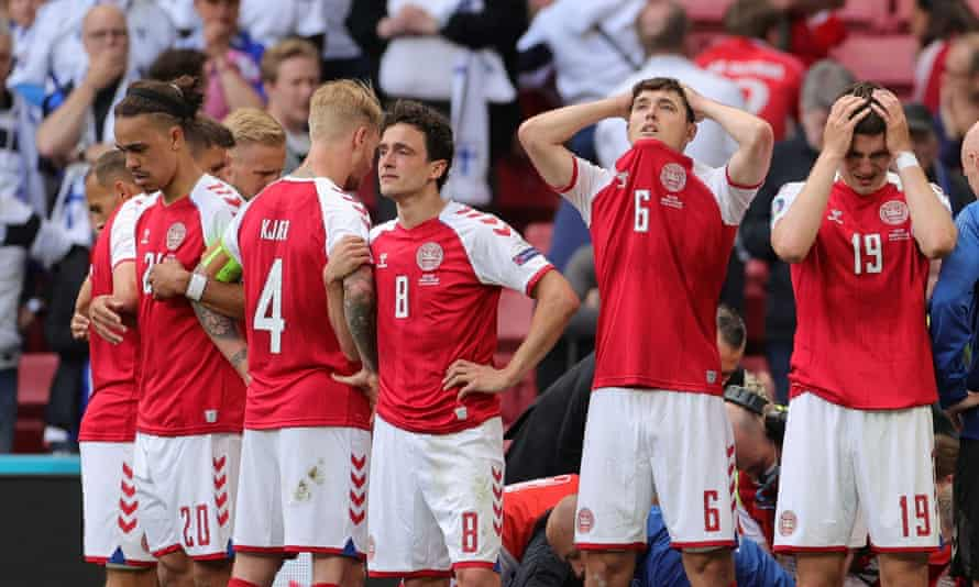 Denmark players stand in front of Christian Eriksen, shielding him from TV cameras while he received urgent medical attention.