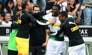 Marcus Thuram (second right) celebrates with his Gladbach teammates after his late winner