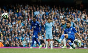 Leicester City's Riyad Mahrez scores from the penalty spot but it is disallowed for kicking the ball twice.