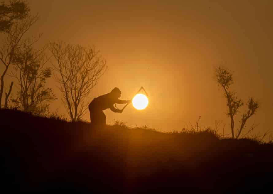 A farmer works at sunrise in Khokana, south of Kathmandu, Nepal, january 2021