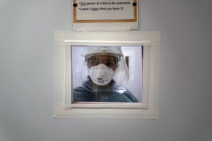 A nurse looks through a window at a hospital in Mission Viejo, California