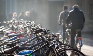 Cyclists ride through central Cambridge, UK.