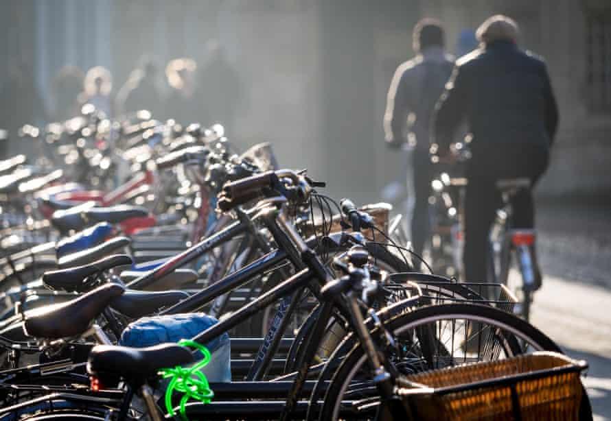Cyclists ride through central Cambridge.